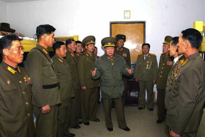VMar Choe Ryong Hae meets with KPA personnel participating in national seminar of construction workers in 2013 (Photo: NKLW).
