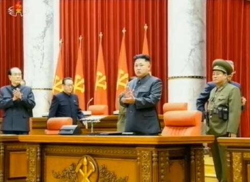 Kim Jong Un (2nd R) applauds at the start of a 8 December 2013 expanded KWP Political Bureau meeting (Photo: KCTV screen grab).