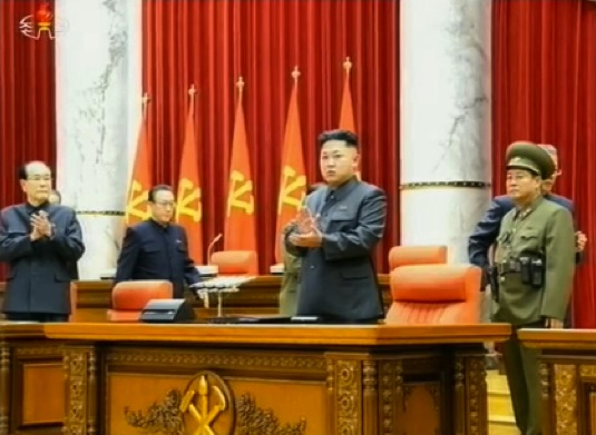Kim Jong Un (2nd R) applauds at the start of a 8 December 2013 expanded KWP Political Bureau meeting (Photo: KCTV screen grab).