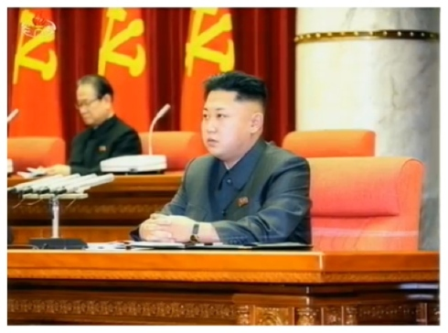 Kim Jong Un attends an expanded KWP Political Bureau meeting in Pyongyang on 8 December 2013.  Also seen in attendance is Kim Yong Il (L), KWP Secretary and Director of the International Affairs Department (Photo: KCTV screen grab).
