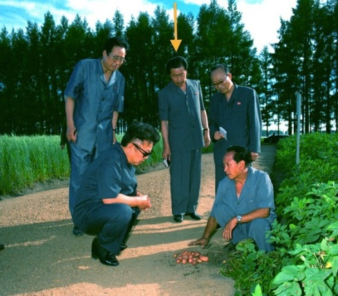 Jang Song Taek attends Kim Jong Il's visit to a farm in the 1990s (Photo: KCNA/NK Leadership Watch file photo).