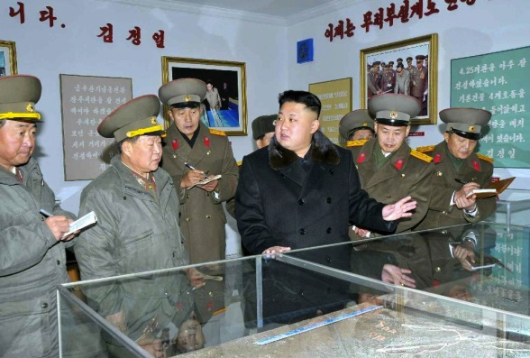 Kim Jong tours a historical exhibition at the KPA Design Institute.  Also in attendance are Gen. Jang Jong Nam, Minister of the People's Armed Forces (L), and VMar Choe Ryong Hae, Director of the KPA General Political Department (2nd L) (Photo: Rodong Sinmun).