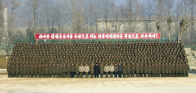 Kim Jong Un attends a commemorative photo-op with officers and service members of the command element of KPA Unit #526 (Photo: Rodong Sinmun).