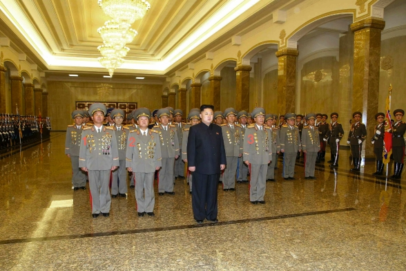 Kim Jong Un visits the Ku'msusan Palace of the Sun in Pyongyang on 24 December 2013.  Also seen in attendance are: Minister of the People's Armed Forces Gen. Jang Jong Nam (1), Director of the KPA General Political Department VMar Choe Ryong Hae (2) and Chief of the KPA General Staff Gen. Ri Yong Gil (3) (Photo: Rodong Sinmun).