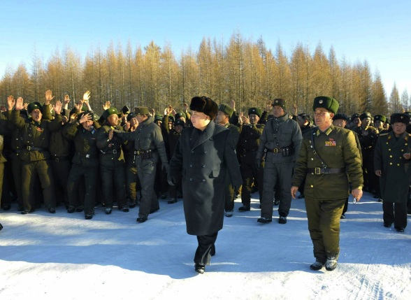 Kim Jong Un with officers and service members of KPA Air and Anti-Air Force Unit #991 (Photo: Rodong Sinmun).