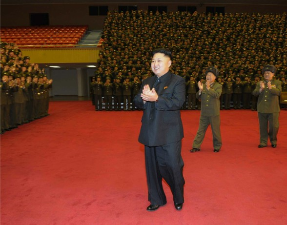 Kim Jong Un attends a photo-op with participants in a meeting of frontline soldiers.  Also seen in attendance are Director of the KPA General Political Department VMar Choe Ryong Hae (2nd R) and Minister of State Security Gen. Kim Won Hong (R) (Photo: Rodong Sinmun).