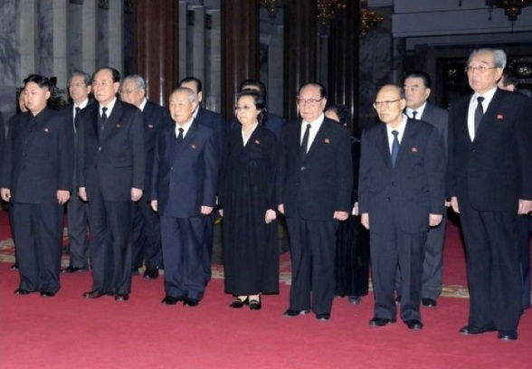 Kim Kuk Ta'e (2nd R) viewing the body of late DPRK leader Kim Jong Il in December 2011 (Photo: KCNA).
