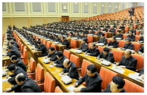 Participants with observer status attend an 8 December 2013 expanded meeting of the KWP Political Bureau (Photo: KCTV screen grab).