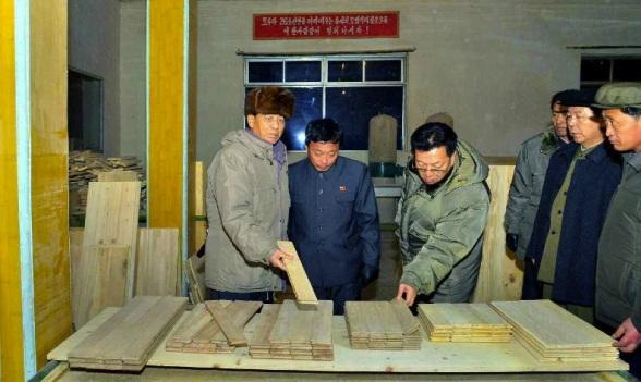 DPRK Premier Pak Pong Ju (L) inspects products of the Kanggye Wood Processing Factory in Kanggye, Chagang Province (Photo: Rodong Sinmun).