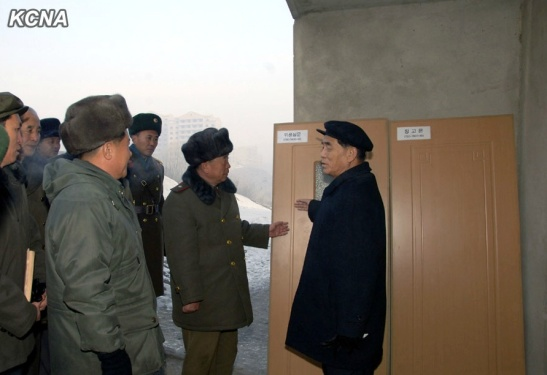 DPRK Premier Pak Pong Ju (R) tours the construction of an apartment complex in the Ryongsong-Sop'o section of Pyongyang (Photo: Rodong Sinmun).