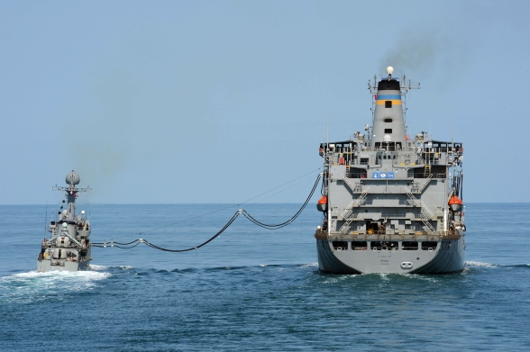 The Military Sealift Command fleet replenishment oiler USNS Pecos (T-AO 197), right, performs a replenishment-at-sea with the South Korean Patrol Combat Corvette Puchon (PCC 773) in the Yellow Sea during exercise Foal Eagle 2013 on March 15, 2013. Ships from the U.S. 7th Fleet and the Republic of Korea were underway for exercise Foal Eagle 2013  (Photo: DOD by Petty Officer 3rd Class Declan Barnes).