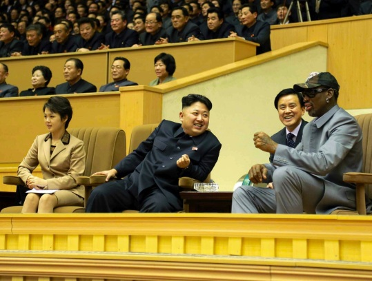 Kim Jong Un (C) watches a basketball game between US and DPRK players at Pyongyang Indoor Stadium on 8 January 2013.  Also in attendance is Kim Jong Un's wife Ri Sol Ju (L) (Photo: Rodong Sinmun).