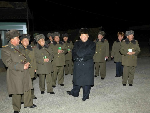 Kim Jong Un and senior members of the Korean People's Army high command attend nught jump exercises by KPA airborne service members (Photo: Rodong Sinmun).