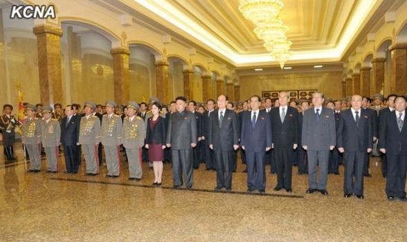 Kim Jong Un (8th L) and his wife Ri Sol Ju (7th L) visit Ku'msusan Palace of the Sun in Pyongyang on 1 January 2014.  Also seen in attendance are Gen. Kim Won Hong (L), VMar Kim Yong Chun (2nd L), Pak To Chun (3rd L), Gen. Jang Jong Nam (4th L), Gen. Ri Yong Gil (5th L), VMar Choe Ryong Hae (6th L), Kim Yong Nam (6th R), Pak Pong Ju (5th R), Kim Ki Nam (4th R) Choe T'ae Bok (3rd R), Yang Hyong Sop (2nd R) and Kang Sok Ju (R) (Photo: KCNA).