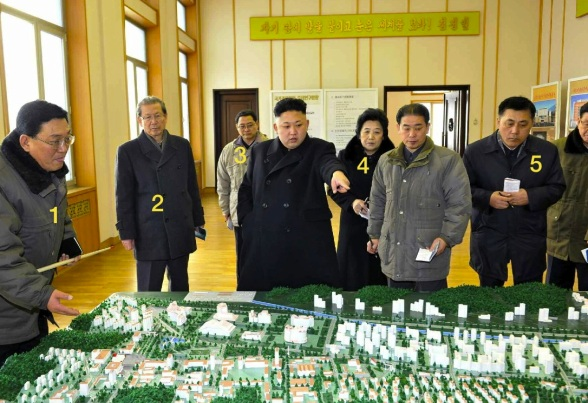 Kim Jong Un views a scale model at the State Academy of Sciences.  Also in attendance are: President of the State Academy of Sciences Jang Chol (1), KWP Secretary Choe T'ae Bok (2), KWP Organization Guidance Department Deputy Director Pak Thae Song (3), KWP Science Education Department Director Han Kwang Bok (4) and KWP Finance and Accounting Deputy Director Ma Won Chun (5) (Photo: Rodong Sinmun).