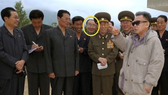 Pak Myong Chol (highlighted) attends a Kim Jong Il visit to a fruit farm in 2009 (Photo: KCNA).