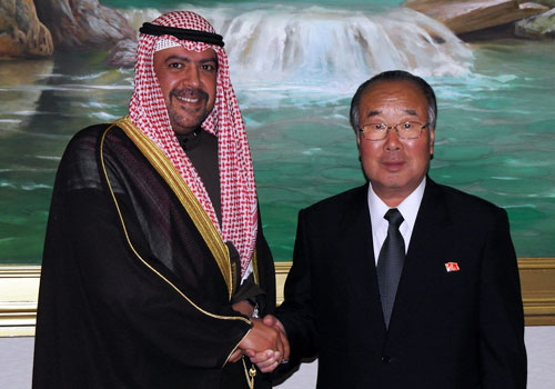 Pak Myong Chol (R) shakes hands with Sheikh Ahmad Al-Fahad Al-Sabah, President of the Olympic Council of Asia, in November 2011 (Photo: OCASIA).