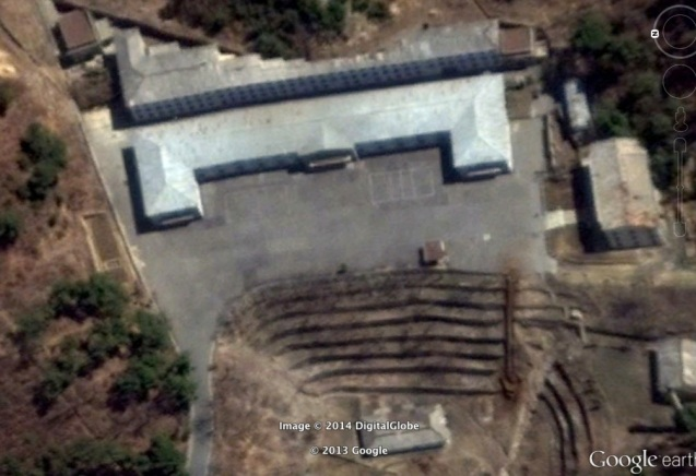 """Entrance and support buildings of a Ministry of State Security complex.  Located within a mountain in north Pyongyang, the complex earned notoriety during a purge in the late 1990s when dozens of officials were executed here.  It has been said that """"once having entered, no one comes out alive."""" (Photo: Google image)."""