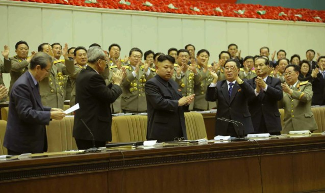 Kim Jong Un applauds at the conference.  Also seen in attendance on the rostrum are Choe Tae Bok (L), Kim Ki Nam (2nd L), Kim P'yo'ng-hae (3rd R), Kwak Pom Gi (2nd R) and Col. Gen. Kim Chang Sop (R) (Photo: Rodong Sinmun).