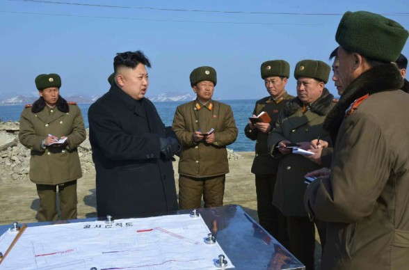 Kim Jong Un gives instructions about the completion of construction of the 8 January Fishery Station of the KPA (Photo: Rodong Sinmun).