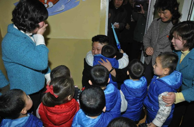 Kim Jong Un hugs a child during a visit to a Pyongyang orphanage and baby home (Photo: Rodong Sinmun).