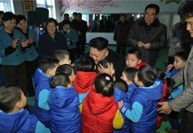 Kim Jong Un greets children at a Pyongyang orphanage and baby home (Photo: Rodong Sinmun).