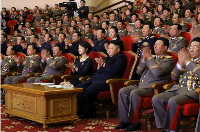 Kim Jong Un and his wife Ri Sol Ju (4th R) attend a concert by the Merited State Choir at the People's Theater in Pyongyang (Photo: Rodong Sinmun).