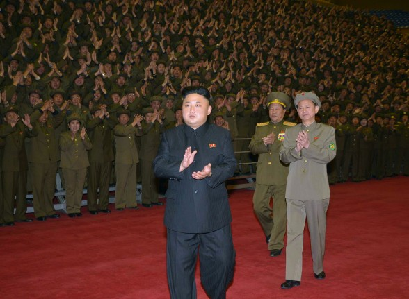 Kim Jong Un greets participants at a commemorative photo-op with participants in a meeting of active personnel of the Worker-Peasant Red Guards.  Also seen in attendance are Minister of People's Security Gen. Choe Pu Il (2nd R) and KWP Military Affairs Department Director O Il Jong (R) (Photo: Rodong Sinmun).