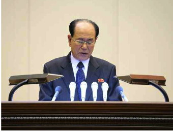SPA Presidium President Kim Yong Nam delivers the report at a meeting marking the birth anniversary of late DPRK leader Kim Jong Il (Photo: Rodong Sinmun).