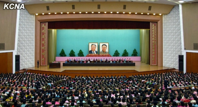 View of the platform at the People's Palace of Culture in Pyongyang, the venue for a central report meeting marking International Women's Day held on 8 March 2014 (Photo: KCTV screen grab).