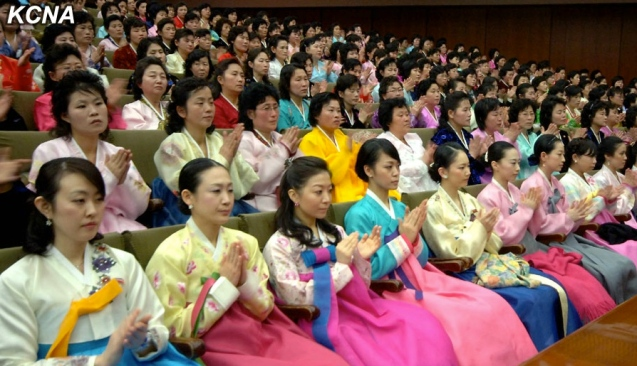 Participants at a central report meeting marking International Women's Day, held in Pyongyang on 8 March 2014 (Photo: KCNA)