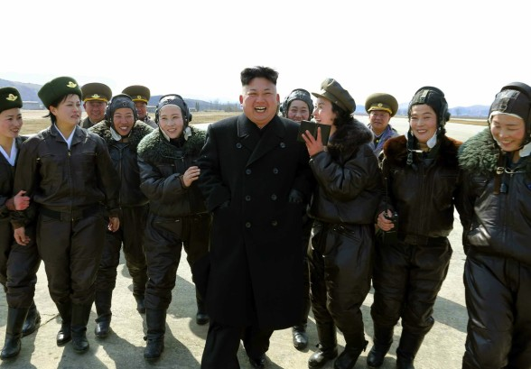 Kim Jong Un with airwomen after a drill by KPA Air and Anti-Air Force #2620 (Photo: Rodong Sinmun).