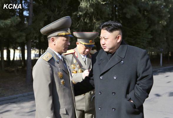 Kim Jong Un talks to SPA deputy candidate Maj. Gen. Kim Kwang Hyok, for whom KJU cast his ballot, in Pyongyang on 9 March 2014 (Photo: KCNA).