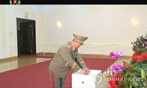 Minister of the People's Armed Forces Jang Jong Nam casts his ballot for Kim Jong Un for SPA deputy  on 9 March 2014 (Photo: KCTV-Yonhap).