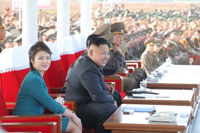 Kim Jong Un observed a flight drill competition of the KPA Air and Anti-Air forces.  Also in attendance is his wife Ri Sol Ju (L).