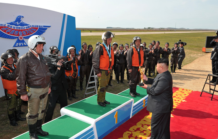 Kim Jong Un presents awards to successful participants in the KPA Air and Anti-Air Force flight drill competition