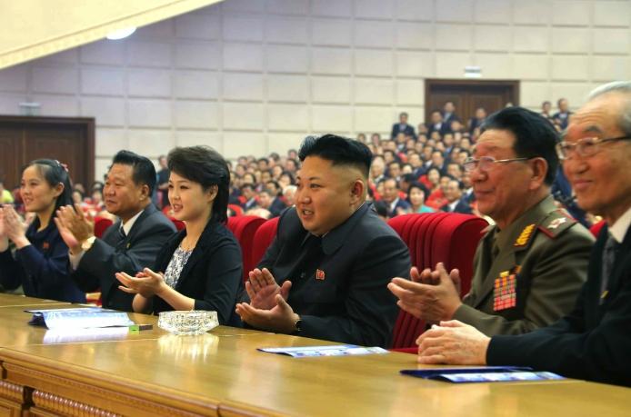 Kim Jong Un applauds during the Moranbong Band concert.  Also in attendance are Kim Yo Jong (1st L), Choe Ryong Hae (2nd L), Ri Sol Ju (3rd (L), VMar Hwang Pyong So (2nd R) and Kim Ki Nam (right) (Photo: Rodong Sinmun).