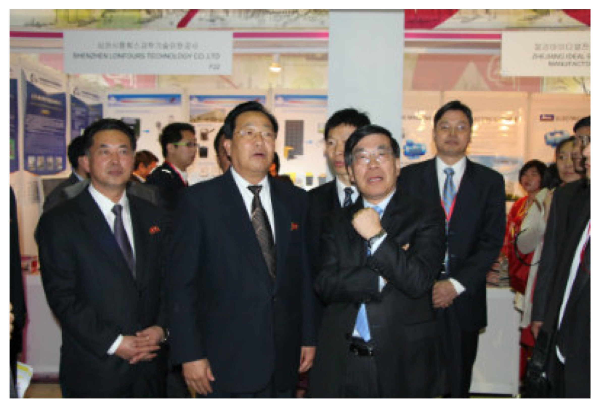 Chinese Ambassador to the DPRK Liu Hongcai (right) visits an exhibition at the Pyongyang Spring International Trade Fair on May 12, 2014.  Also in attendance is DPRK Vice Premier Kim Yong Jin (center) and DPRK Minister of Foreign Trade Ri Ryong Nam (left) (Photo: PRC Embassy in the DPRK).