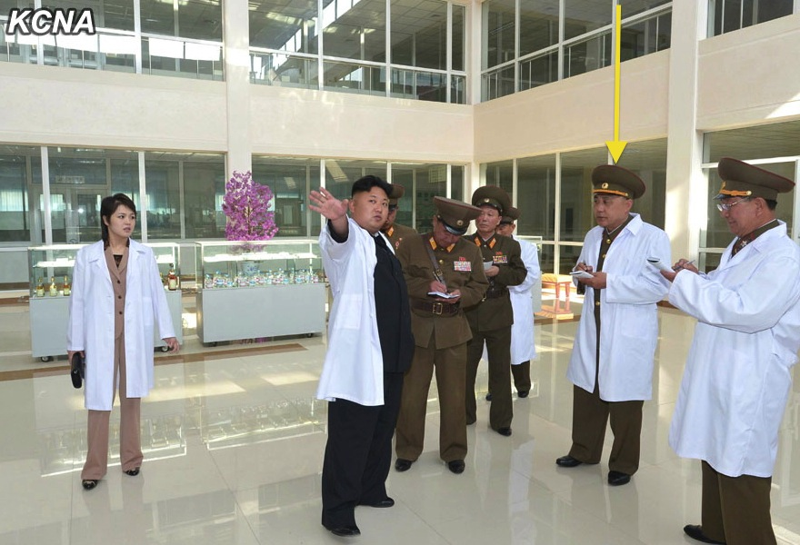 Ma Won Chun (annotated) takes notes during Kim Jong Un's tour of Taeso'ngsan Hospital (Photo: KCNA).