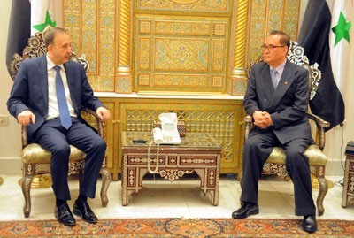 Speaker of the People's Assembly Mohammad Jihad al-Laham (L) meets with DPRK Foreign Minister Ri Su Yong (Photo: SANA).