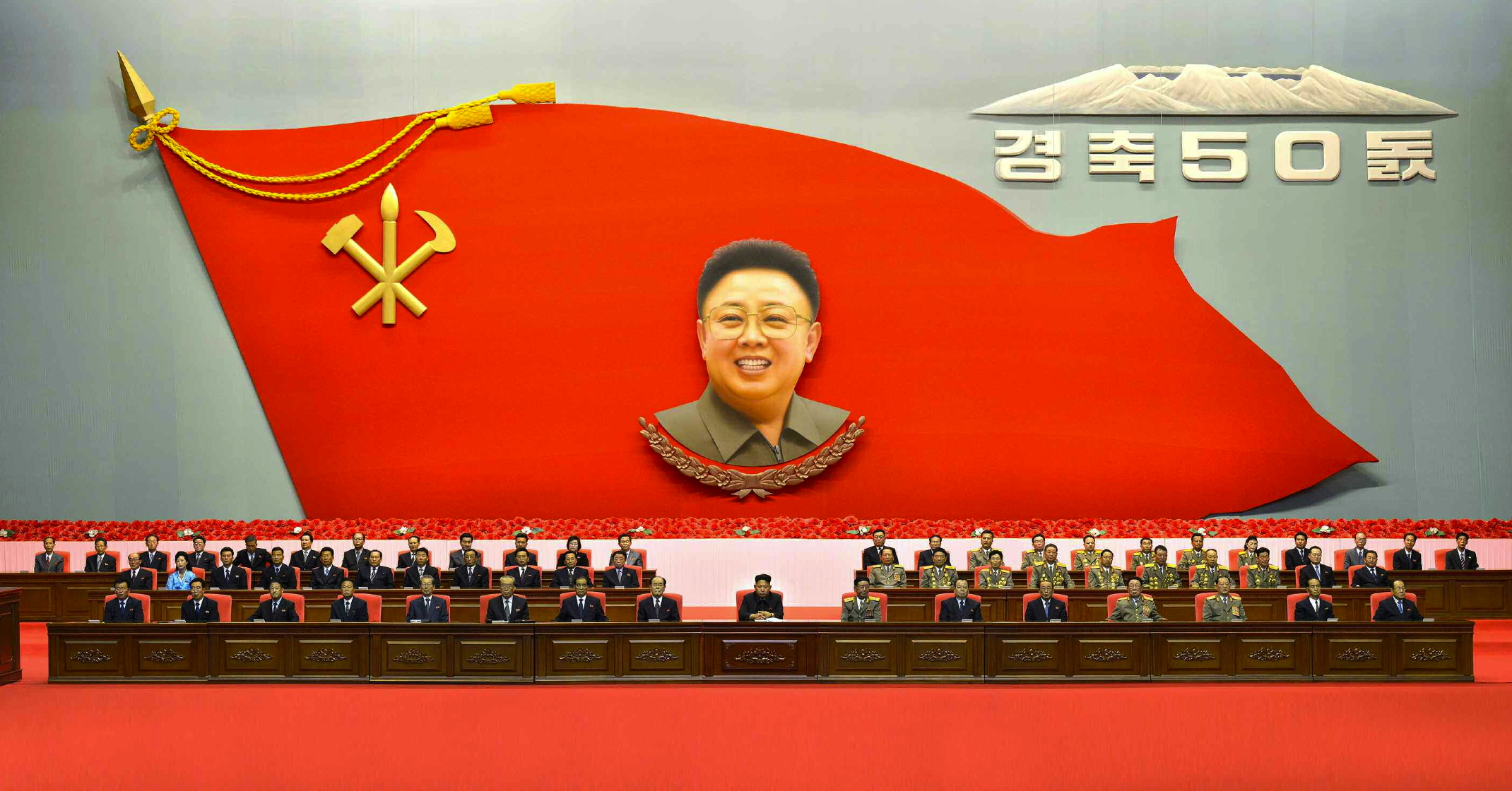 View of the platform at 25 April House of Culture, the venue of a central report meeting commemorating the 50th anniversary of the start of late leader Kim Jong Il's work at the WPK Central Committee (Photo: Rodong Sinmun).