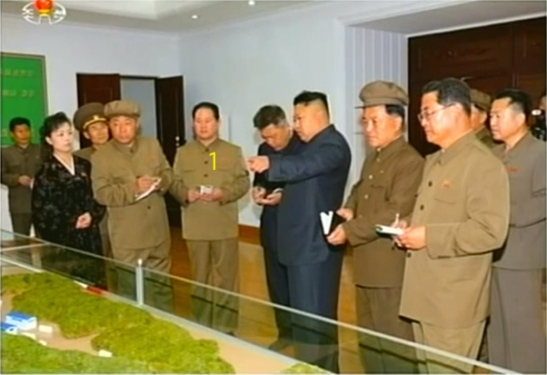 Kim Jong Un visits the January 18 General Machinery Plant in South P'yo'ngan Province in May 2014.  Also in attendance is Hong Yong Chil (1) a leading party official in the development and production of missiles and WMDs (Photo: KCTV).