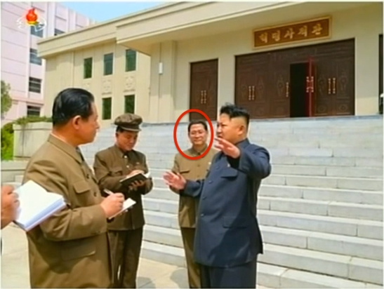 Pak Thae Song (Pak T'ae-so'ng), circled, deputy director of the WPK Organization Guidance Department, attends Kim Jong Un's May 2014 visit to the January 18 General Machinery Plant (Photo: KCTV).