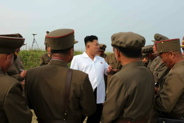 Kim Jong Un speaks to KPA and WPK munitions industry officials after a missile test flight held on or around 26 June 2014 (Photo: Rodong Sinmun).