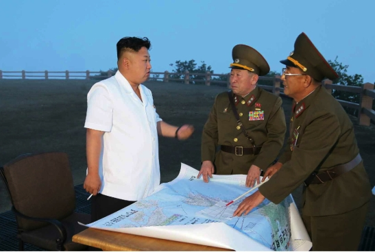 Kim Jong Un talks with KPA Strategic Rocket Force commander Col. Gen. Kim Rak Gyom and the SRF's vice commander (Photo: Rodong Sinmun).