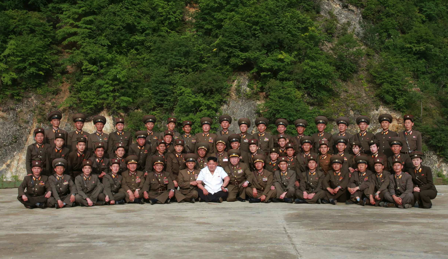 Kim Jong Un poses for a commemorative photo with service members and officers of the KPA Strategic Rocket Force after their participation in a drill on 29 June 2014 (Photo: Rodong Sinmun).