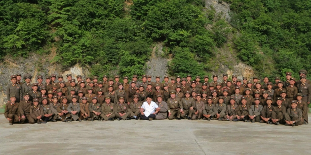 Kim Jong Un poses for a commemorative photo with participants in the KPA Strategic Rocket Force's 29 June 2014 drill that used two short-range Scud missiles (Photo: Rodong Sinmun).