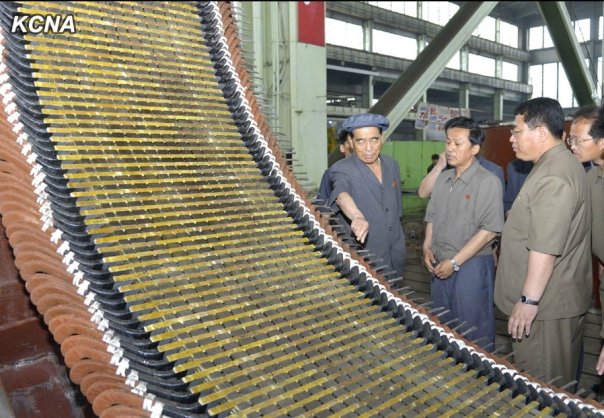 DPRK Premier Pak Pong Ju (L) tours Taean Heavy Machine Complex (Photo: KCNA).
