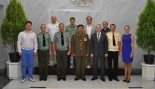 KPA General Political Department Director VMar Hwang Pyong So (4th L) poses for a commemorative photo with members of the Central Military Orchestra of the Ministry of Defense of the Russian Federation in Pyongyang on 2 July 2014 (Photo: Rodong Sinmun).