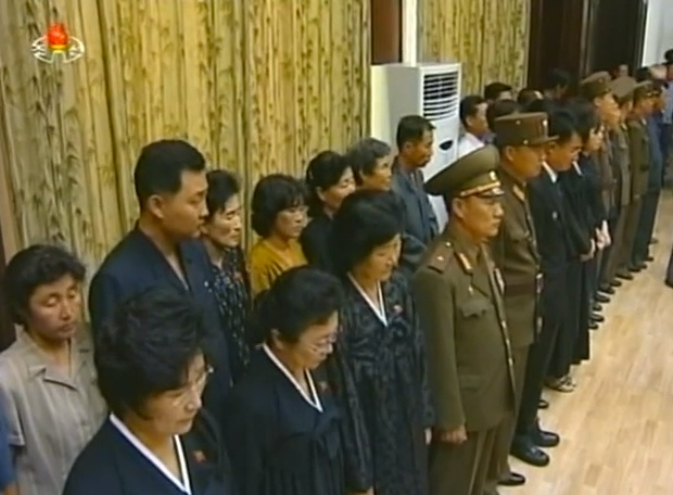 Members of Jon Pyong Ho's family attend his funeral at the Sojang Club in Pyongyang on 10 July 2014 (Photo: KCTV).